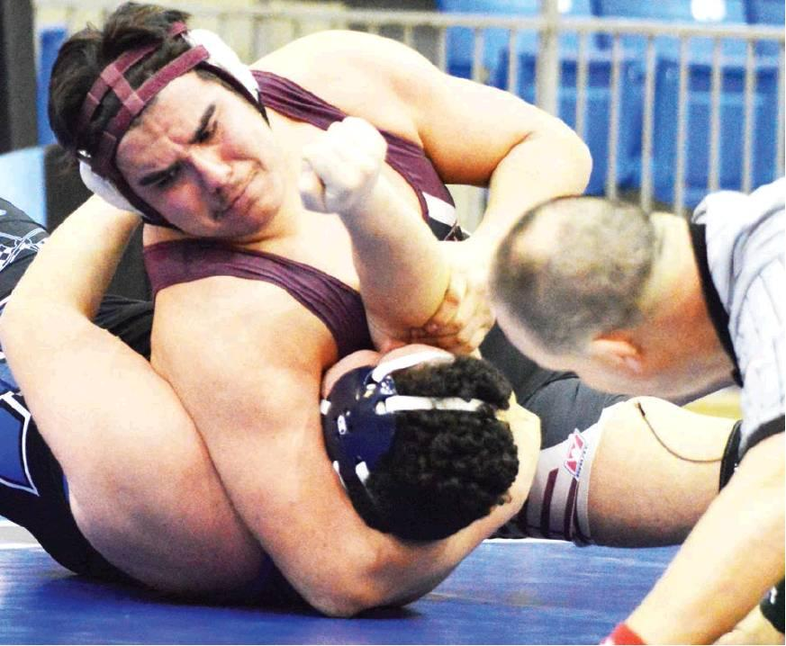 CDN | Collin Wieder                      Clinton heavyweight senior wrestler Ruben Gutierrez, top, puts his Newcastle opponent in a headlock. Gutierrez qualified for state in each of his two varsity seasons and placed third this year.