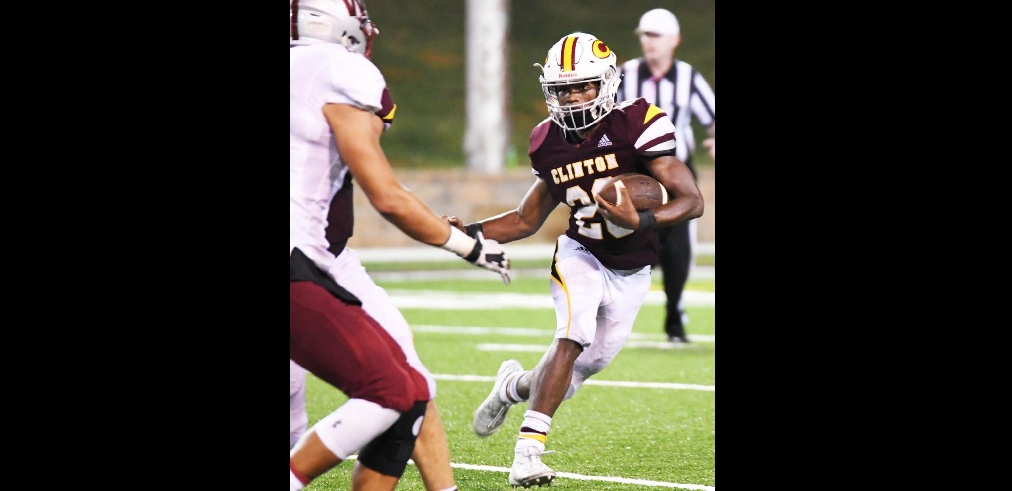 Clinton running back Atrel Bryson bounces a run outside in the win against Weatherford.