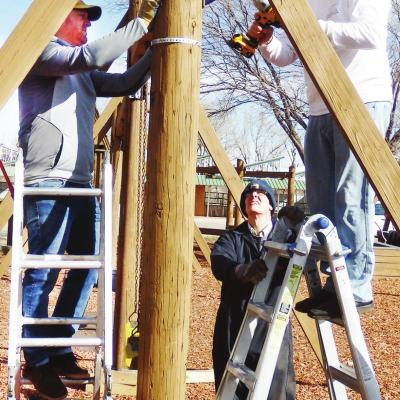Volunteers work on playground
