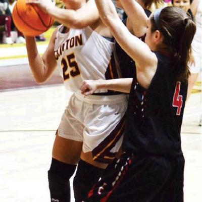 Clinton boys win close one, Lady Reds fall in double overtime