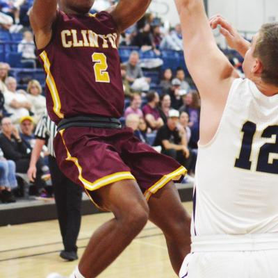 Clinton junior guard Atrel Bryson shoots a fadeaway jumper over a Kingfisher defender. Bryson recorded eight points and three assists in the loss to KF. CDN | Collin Wieder