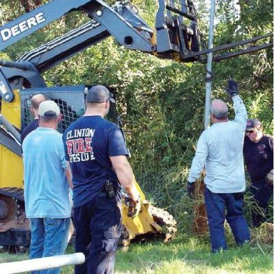 Fire fighters clean up rodeo grounds