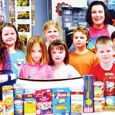 Students help their neighbors
