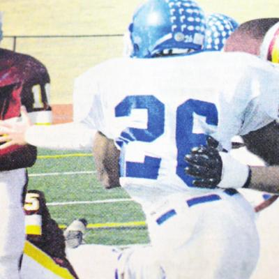 Clinton running back Willie Ford, No. 10, follows a block by teammate Ryan Hall. CDN | File Photo