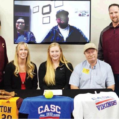 Whitney signs at Carl Albert State