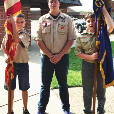 Boy Scouts carry the colors