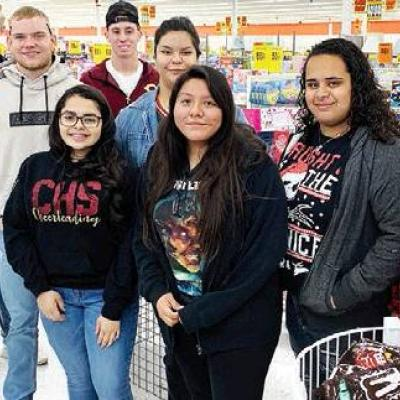 Santa's helpers shop for toys