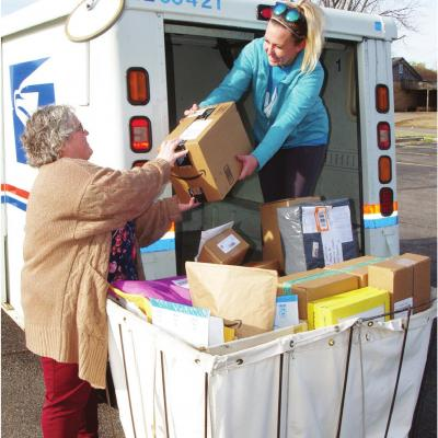 Postal workers providing valuable service