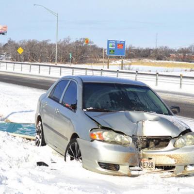 Car strikes exit sign