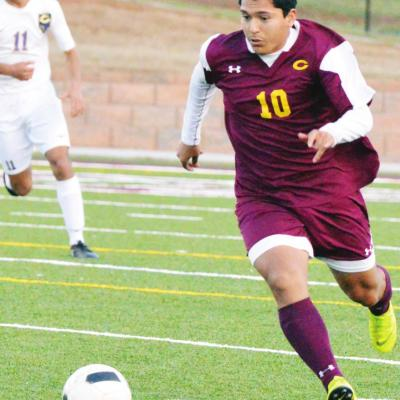 Clinton midfielder Marco Gonzalez dribbles up the field in a game against Chickasha last year. Gonzalez nearly put up 20 goals and 20 assists across the 2018-2019 seasons. CDN   Collin Wieder