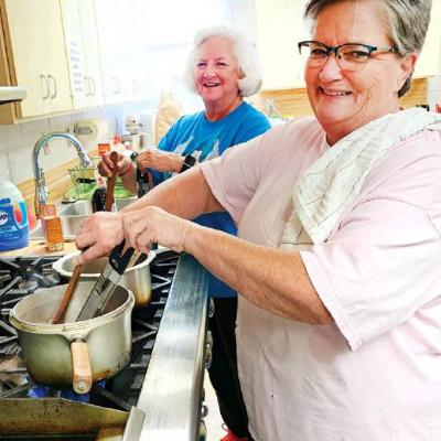 Gal pals help out in church kitchen