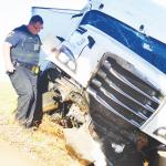 Semi wrecks off I-40